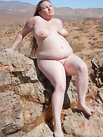 Chubby female nudist taking a sun bath - Chubby Naturists