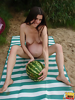 Pregnant lady eating tasty watermelon